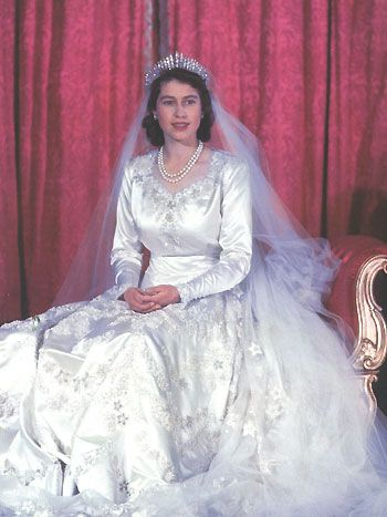 34. When H.M. Queen Elizabeth, then England's Crown Princess, married the dashing Prince Phillip in an often undervalued wedding gown. The ivory silk duchesse satin dress was designed by Norman Hartwell and in postwar-Britain, her royal Highness had to use ration coupons to purchase her dress, featuring seed pearls and different flower motives. London, 1947.