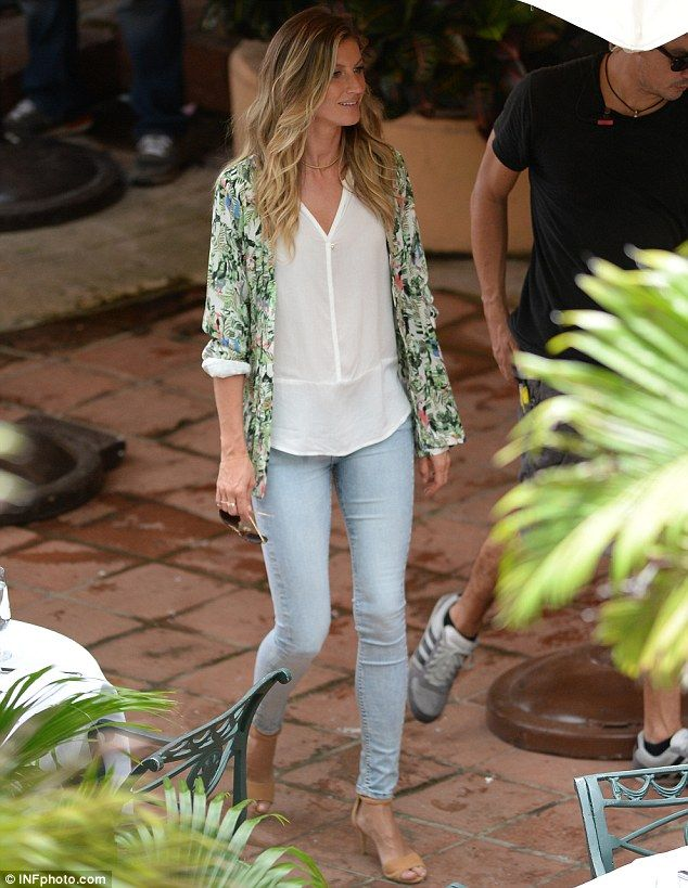Skinny jeans: Gisele wore tight faded jeans on the set of the Falabella commercial...