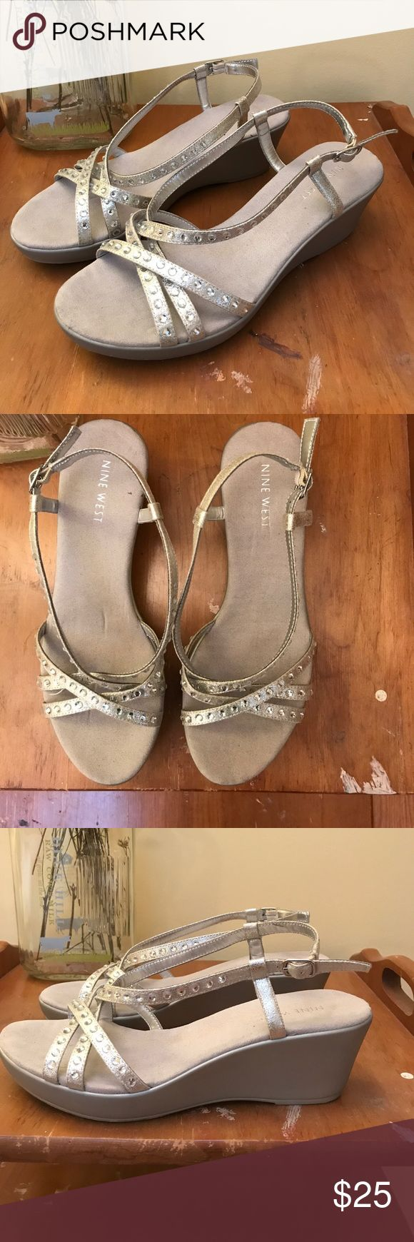 Sparkly silver wedge sandals You can dance the night away with the sparkly silver Easy Spirit wedge sandals. Some signs of wear on the bottom but none on the shoe itself. Worn a few times. Easy Spirit Shoes Platforms