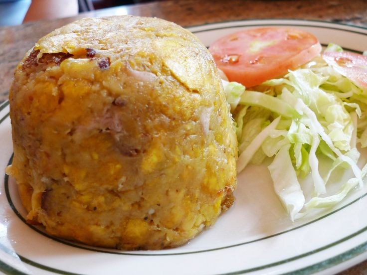 Mofongo, a dish of garlicky mashed plantains, is one of the most popular dishes in Puerto Rico. It has clear roots in the fufu of West Africa