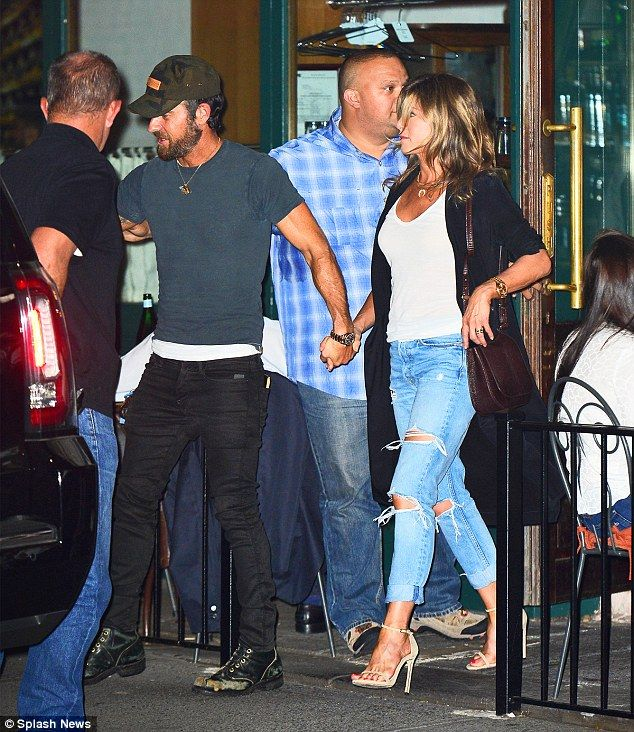 Romantic: Jennifer Aniston and Justin Theroux stepped out for their Tuesday night dinner date at Sant Ambroeus in New York City