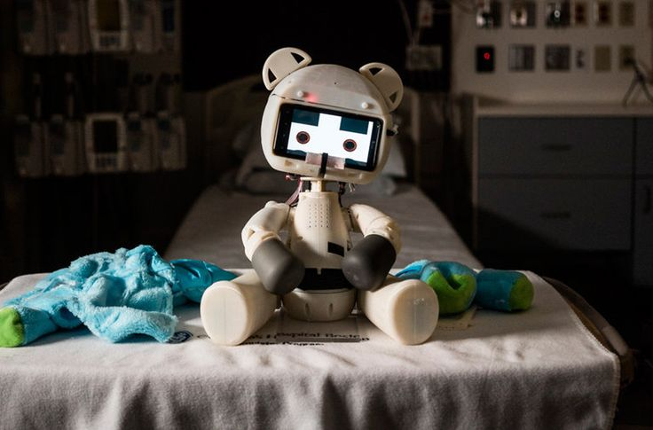 Beatrice Lipp, a patient at Boston Children's Hospital, meets Huggable, a robotic teddy bear. The robot's creators are studying whether it can have therapeutic value for hospitalized children.
