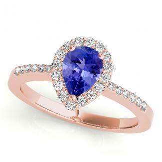 1.7ct Pear Tanzanite Ring With .224ctw Diamonds in 14k Rose Gold. toptanzanite.com #tanzanitering