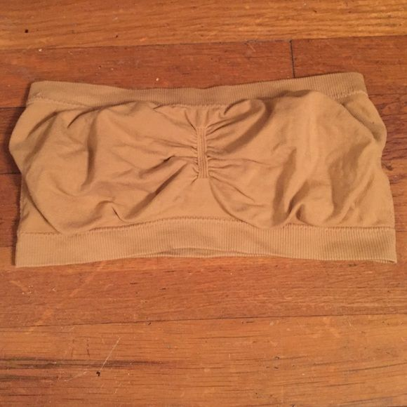 Nude Bandeau Top Good condition. I find it hard to find ones large enough for DDD, and this one is! Super stretchy and could fit a variety of sizes. Buy 2 items $6 or less, get one free! Just comment on the 3 items you want and I'll make you a custom listing! Angelina Intimates & Sleepwear Bandeaus