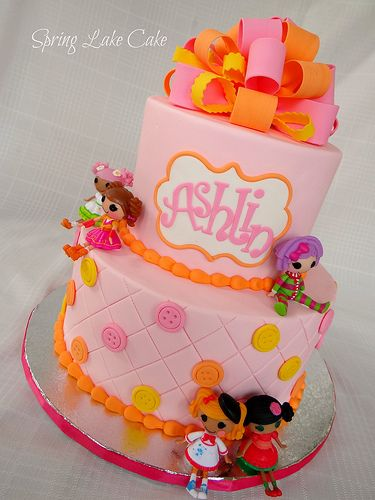 lalaloopsy cake... maybe something like this but less ugly topper... bottom layer is cute!
