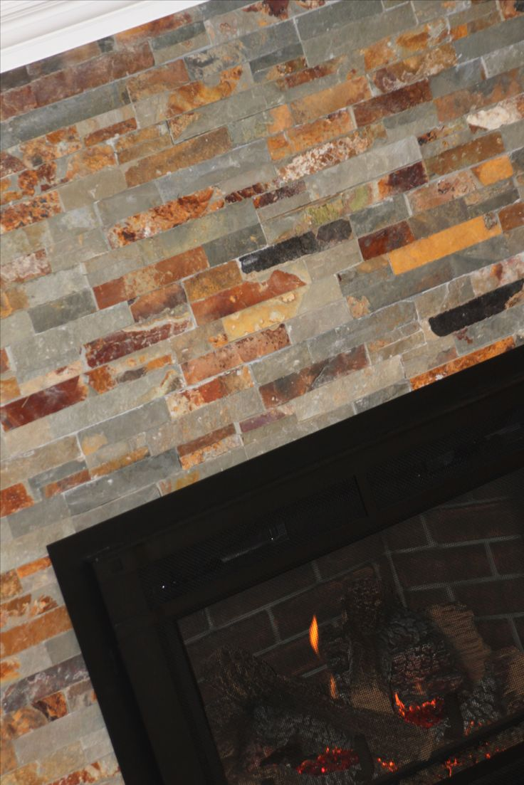 Fireplace slate from Lowes.  I tiled right over existing painted brick face.  Added the wood trim and painted white.  Gas insert was installed after the tile has a chance to cure and dry.