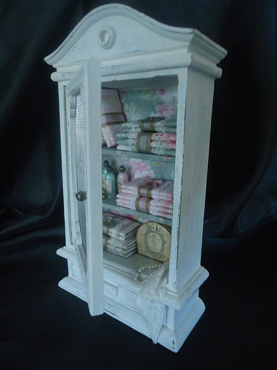 Accessorized shabby chic linencabinet 1/12th scale.