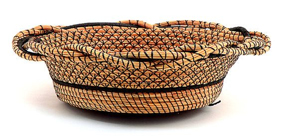 Mirth and Joy A pine needle basket with braded rim and