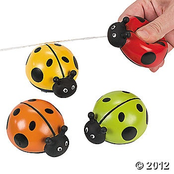 Ladybug water squirters for favors.