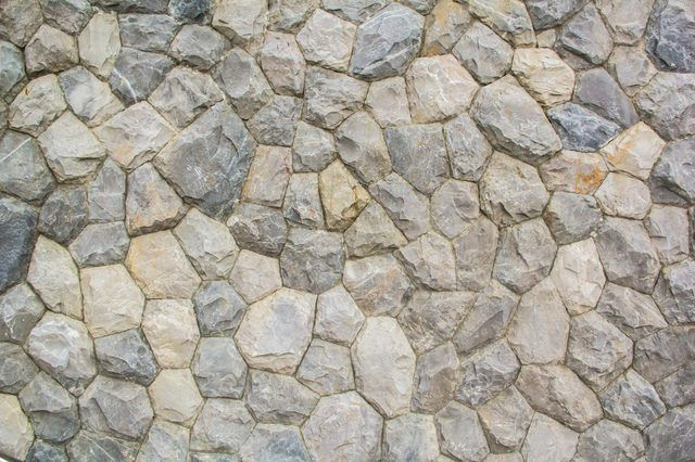 Boulder rock retaining walls look natural in any landscape. A retaining wall needs to be strong to support the soil behind, and boulders naturally perform this task. Boulder...