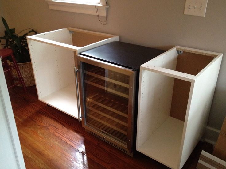 kitchen cabinets into bar | the cabinets, placed our wine fridge between two Akurum base cabinets ...