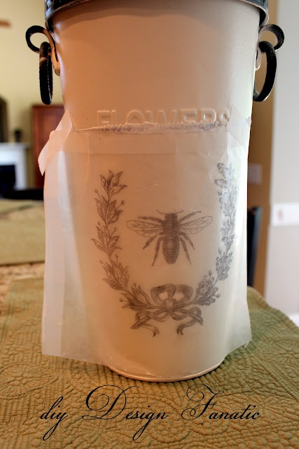 After painting my flower pot and printing the image on the wax paper, the image was tranferred to the metal bucket.