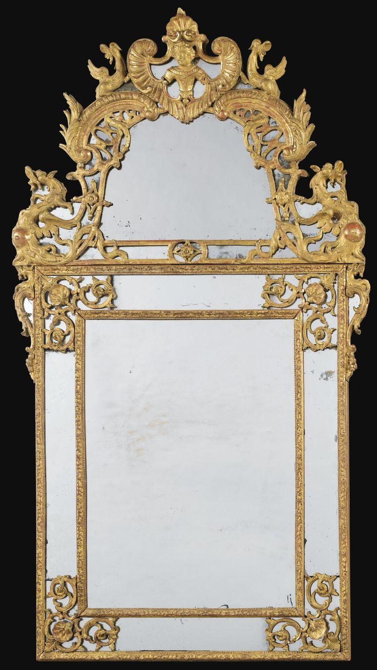 Miroir  parecloses en bois redor d'poque Rgence.