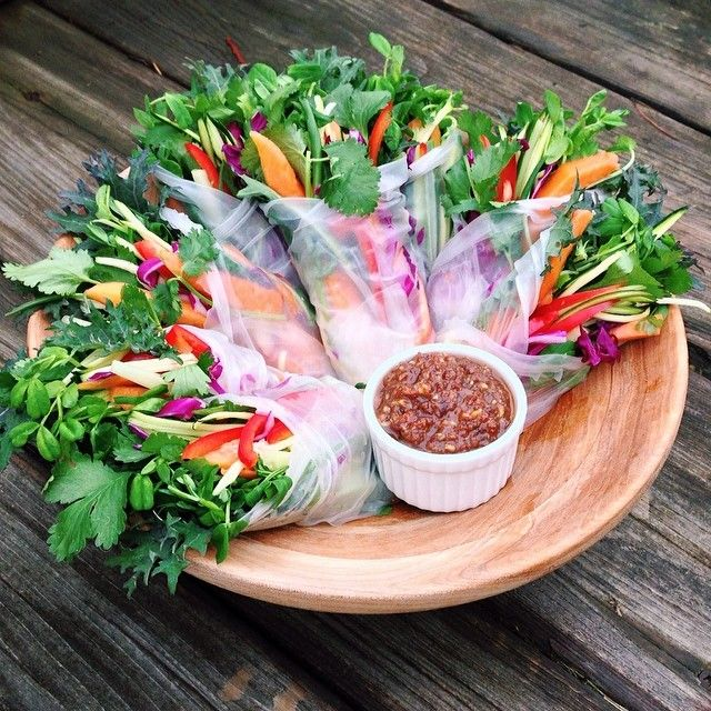 """Fresh veggie & papaya spring rolls w/ raisin chutney!  I filled rice paper wraps with baby kale, cilantro, pea sprouts, red cabbage, papaya, cucumber,…"""