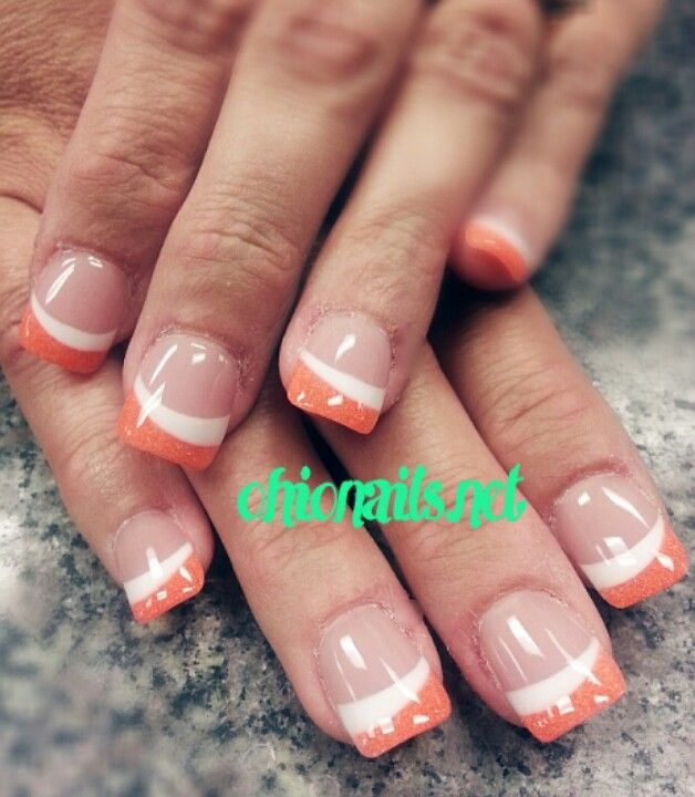 Orange glitter & white acrylic french tips.