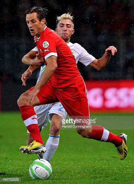 Reto Ziegler of Switzerland and Kevin Kampl of Slovenia in action during the FIFA 2014 World Cup Qualifier match between Switzerland and Slovenia...