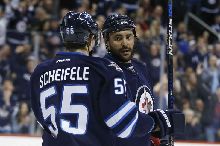 Winnipeg Jets' Mark Scheifele (55) and Dustin Byfuglien (33) celebrate Byfuglien's goal against the Florida Panthers during the second perioPanther power prevails against Jets - Winnipeg Free Press