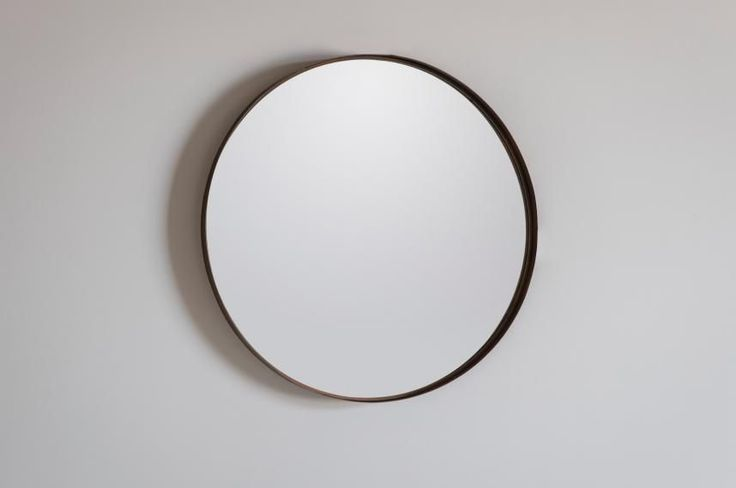 A Scandi, simple, mirror that makes the room look much bigger than it really is