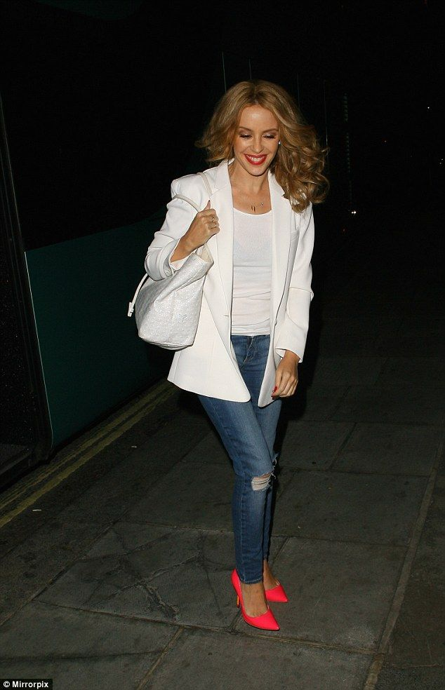 Stand out: She wore the stilettos with jeans, a white vest top and jacket after her Kiss M...