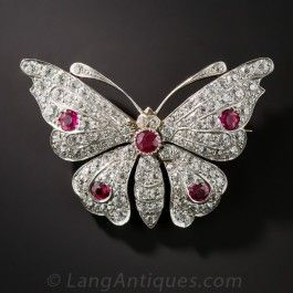 This ravishing and exceptionally well crafted Edwardian butterfly brooch is constructed in the long gone platinum over gold technique. It features five vibrantly colored rubies and is further blanketed with 2.10 carats of bright white European-cut diamond,s glistening atop this fabulous antique butterfly. Complete with flip-out bail on the reverse to be worn as a pendant if you so choose. 1 1/2 by 1 1/8 inches. A rare beauty!