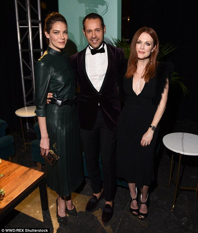 Creative effort: Julianne caught up with actress Michelle Monaghan and Salvatore Farragamo...