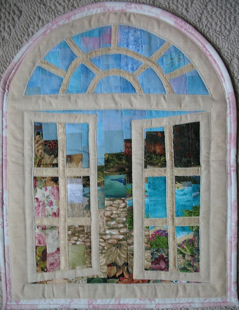 I ❤ quilting . . . This is the watercolor quilt that Colleen made for me for our swap. What a clever design. I am so lucky it is mine! I call it my ocean view. It really evokes a romantic image in my mind. I am at a beautiful Caribbean resort looking out my window at a lovely garden with a cobble path leading to an aqua blue lagoon. A warm salty breeze wafts through my window from the ocean just beyond. I have cabin fever after 5 months of winter, but I still love this quilt. Thanks Colleen!