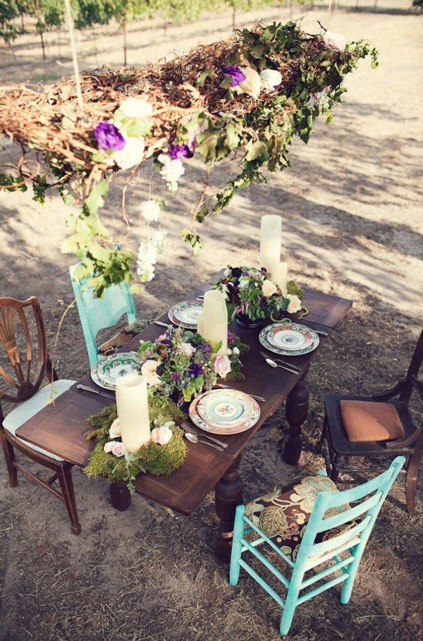 Love the mismatched chairs and china for a vineyard wedding