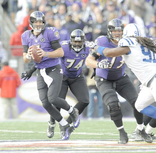 Michael Oher and Marshal Yanda protect Joe Flacco.