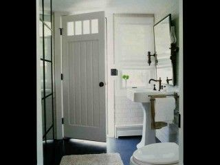 Bathrooms with no windows can use light from another room via a front door with cutouts (just add window liners/frosting for privacy).