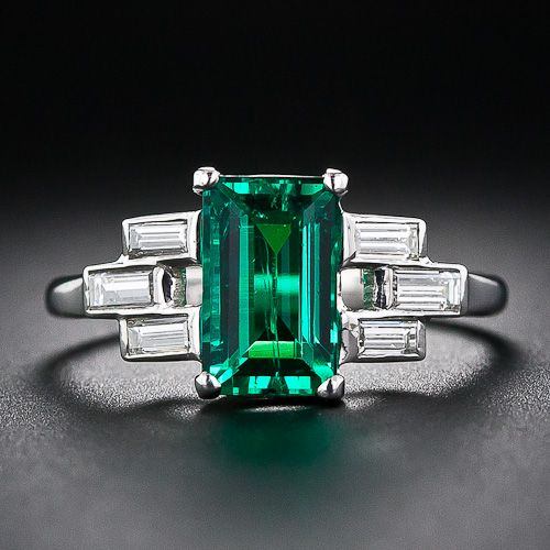 A delicate basket weave in baguette diamonds frame this incredibly high quality emerald. This fine Colombian gem emerald is close to flawless to the naked eye, a rare occurrence in emerald, and richly saturated with a deep green color. If you have been dreaming of a special emerald to grace your fingers this may be the one