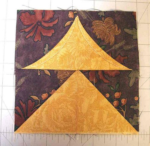 I mentioned the incredible one seam dimensional flying geese demonstrated in the sample video over at The Quilt Show (with Alex Anderson and Ricky Tims). I gave it a try today, and was amazed at ho…