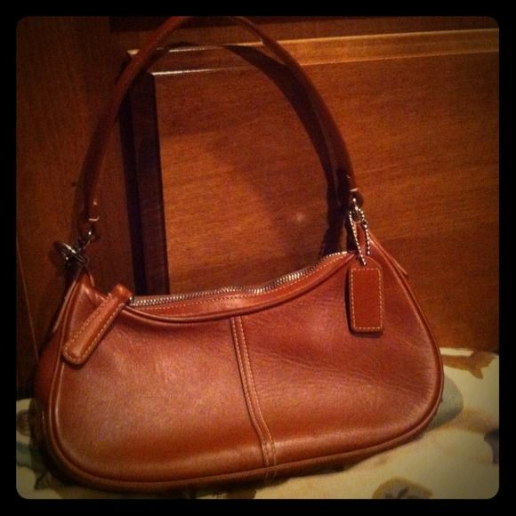 NWOT! Authentic rich brown Coach purse! Price drop Great rich tones! Goes well with anything on any occasion :) was a birthday gift and never used. Mother-In-Law gave it to me as a gift and I don't want to tell her I usually prefer bigger purses. New without tags. Coach Bags