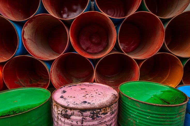 An arrangement of colorful barrels, stacked by the side of the road in Ubud, Bali make for a vivid and symmetrical composition.