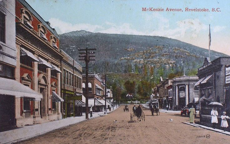 """""""McKenzie Avenue, Revelstoke, B.C."""" .  View looking NE up McKenzie Avenue from the 200-block towards the intersection at 1st Street in Revelstoke, BC., 1910"""