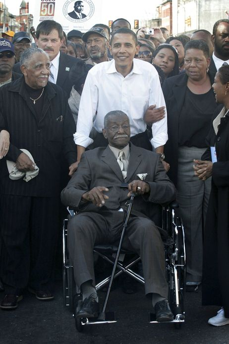 """In this file photo from 2007, Sen. Barack Obama pushes civil rights activist Rev. Fred Shuttlesworth during a commemoration of the 1965 """"Bloody Sunday"""" Voting Rights march in Selma, Ala. Shuttlesworth died Wednesday, at age 89."""