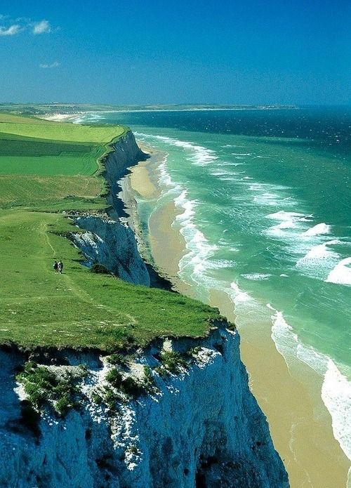 Cap Blanc Nez -France... Incredible shades of blue and green, in the ocean and appearing on the cliff above.. The colors are brilliant and are so full effervescence. Flowing with the ocean breezes.