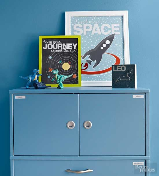 Playful space art is an easy, affordable way to create a space theme in a kid's bedroom.