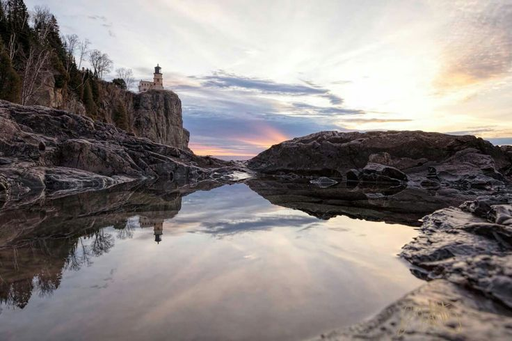 Split Rock Reflections 2/19/17 Split Rock Lighthouse, Two Harbors, MN Photo by Jim Schnortz Photography  This shot involved me hand holding my camera right above a puddle in order to get the reflection of the lighthouse. Taken just after sunrise this morning.  Canon 5Ds with 11-24mm f/4L @ 24mm, f/11, 1/20 second, ISO 200