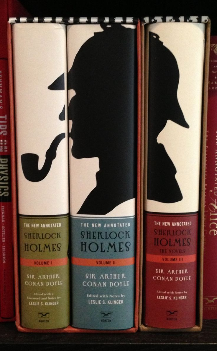 a collection of 3 Sherlock Holmes books! with his shadow of him wearing his famous hat and pipe!