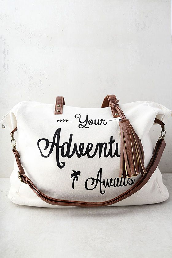 "Excitement is on the horizon with the Adventure Ahead Tan and Cream Weekender! Cream canvas shapes this large weekender bag with, ""Your Adventure Awaits"" printed in large black letters at front. Tan vegan leather handles and tassel accents. Unzip to reveal a spacious interior with two side pockets and one zipped side pocket. Carry from twin tote handles with a 10"" drop or clip on the adjustable shoulder strap (measures 45"" at longest)."