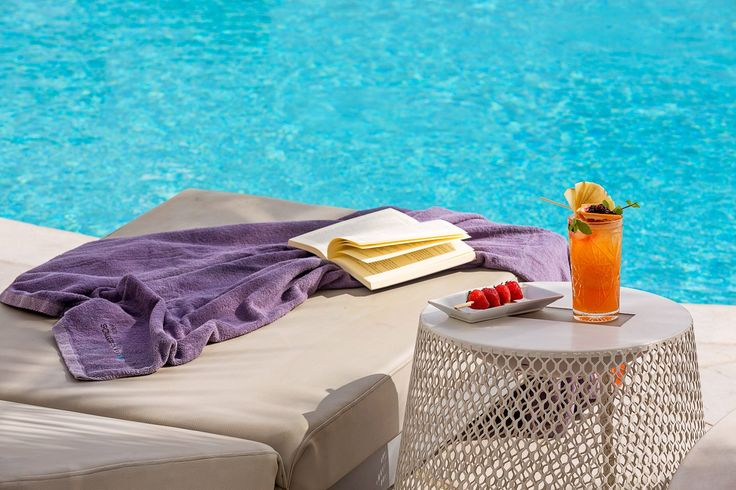 Remembering the wonderful afternoons, reading a book by the pool while enjoying a refreshing cocktail