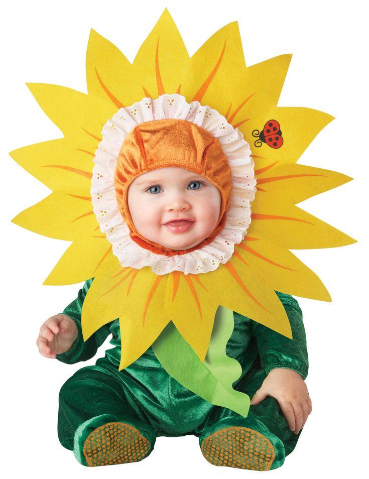 Costume girasole per neonato - Classico: Questo costume da girasole per neonato é composto da una tutina e un copricapo.La tutina, verde scuro, é fatta in un tessuto morbido al tatto. Una foglia verde chiaro parte dal collo...