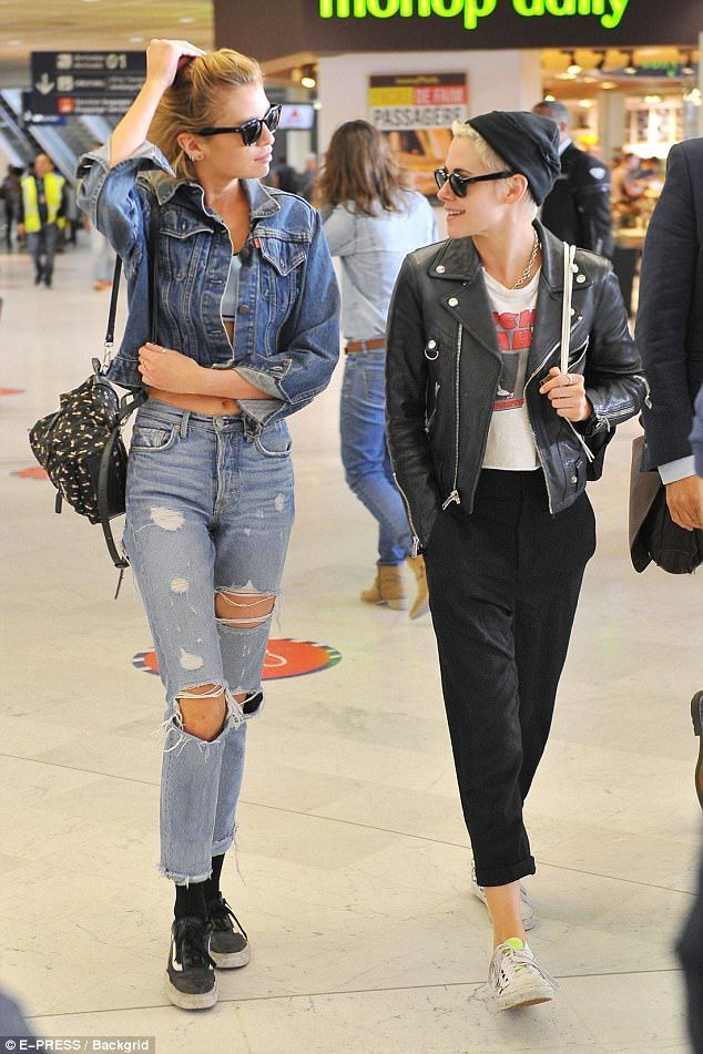 Going strong: Girlfriends Stella Maxwell and Kristen Stewart, both 27, looked very much in love as they arrived in Paris on Thursday