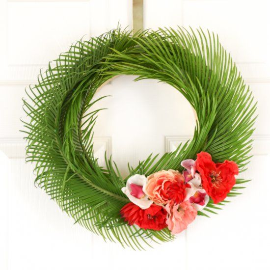 Learn how to make a tropical summer palm leaf wreath two different ways. One heavy on the flowers and one heavy on the palm leaves.