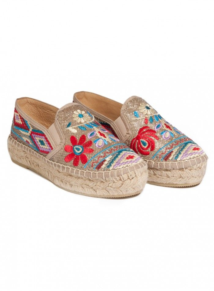 Nepentha Espadrille Classic with a twist; that's the Johnny Was NEPENTHA ESPADRILLE. With all the signature stylings of this vacation-ready shoe but given our boho treatment with a rich embroidery design of flowers across the top and graphic diamond pattern on the sides and heel. Add the braided platform made from a natural jute and traditional blanket stitch around the edge and this is laid-back and lovely.  —100% Polyester top —Jute platform —Rubber sole —Slip on style —Elastic strips on…