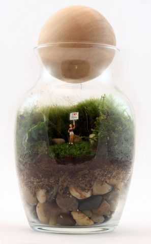 Gentle Reminder by Twig Terrariums. In case you don't say it often enough, or you take a lot of business trips, the Gentle Reminder Terrarium—featuring a tiny figurine holding a brazen I Love You sign—can do it for you, albeit it in a novel, otherworldly way.  American Made. See the designer's work at the 2015 American Made Show, Washington DC. January 16-19, 2015. americanmadeshow.com #terrarium, #iloveyou, #americanmade
