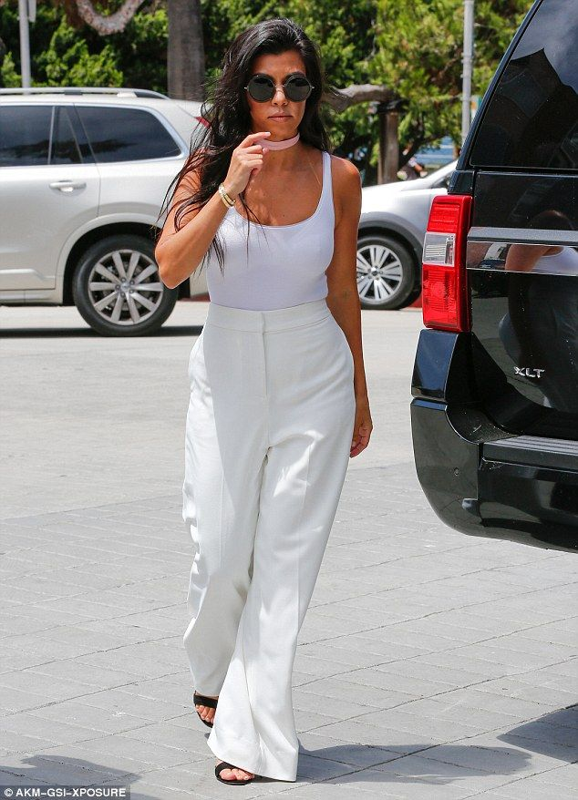 Kourtney Kardashian is a vision in white tank top with high-waisted trousers while ex Scott Disick dons flamboyant floral jacket as they head to the races | Daily Mail Online