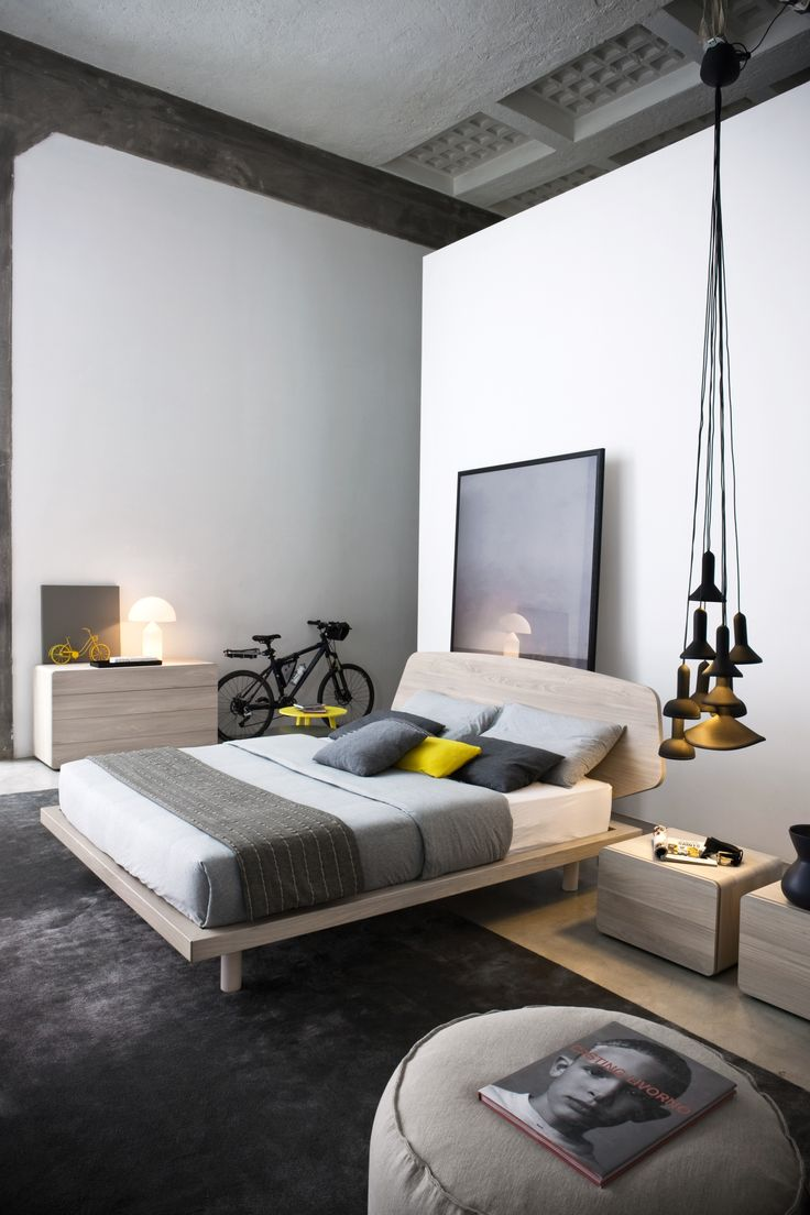 platform bed in contemporary design with pendant lights