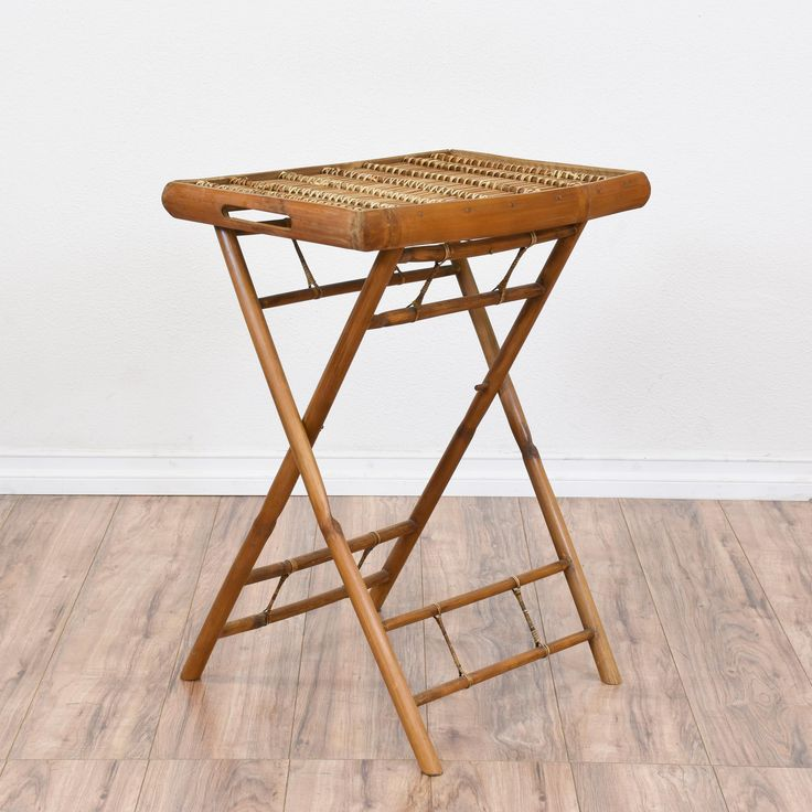 This tropical folding tray is featured in a durable bamboo with a glossy raw finish. This side table is in great condition with a folding base, removable tray top and woven details. Beach chic table perfect for a covered porch of patio! #tropical #tables #endtable #sandiegovintage #vintagefurniture