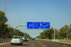 Abu Dhabi, UAE: Driving into the capital city from Dubai. stock photo